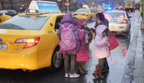 Students, with no bus available, take taxis. Mark Lennihan/AP