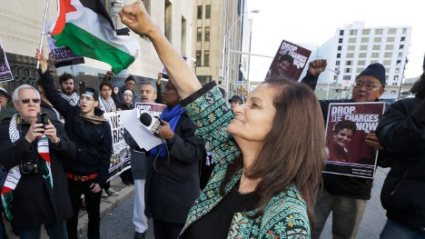 Rasmieh Yousef Odeh, 67, center, gestures toward her supporters outside federal court in Detroit, Monday, Nov. 10, 2014. Photo: Carlos Osorio/AP
